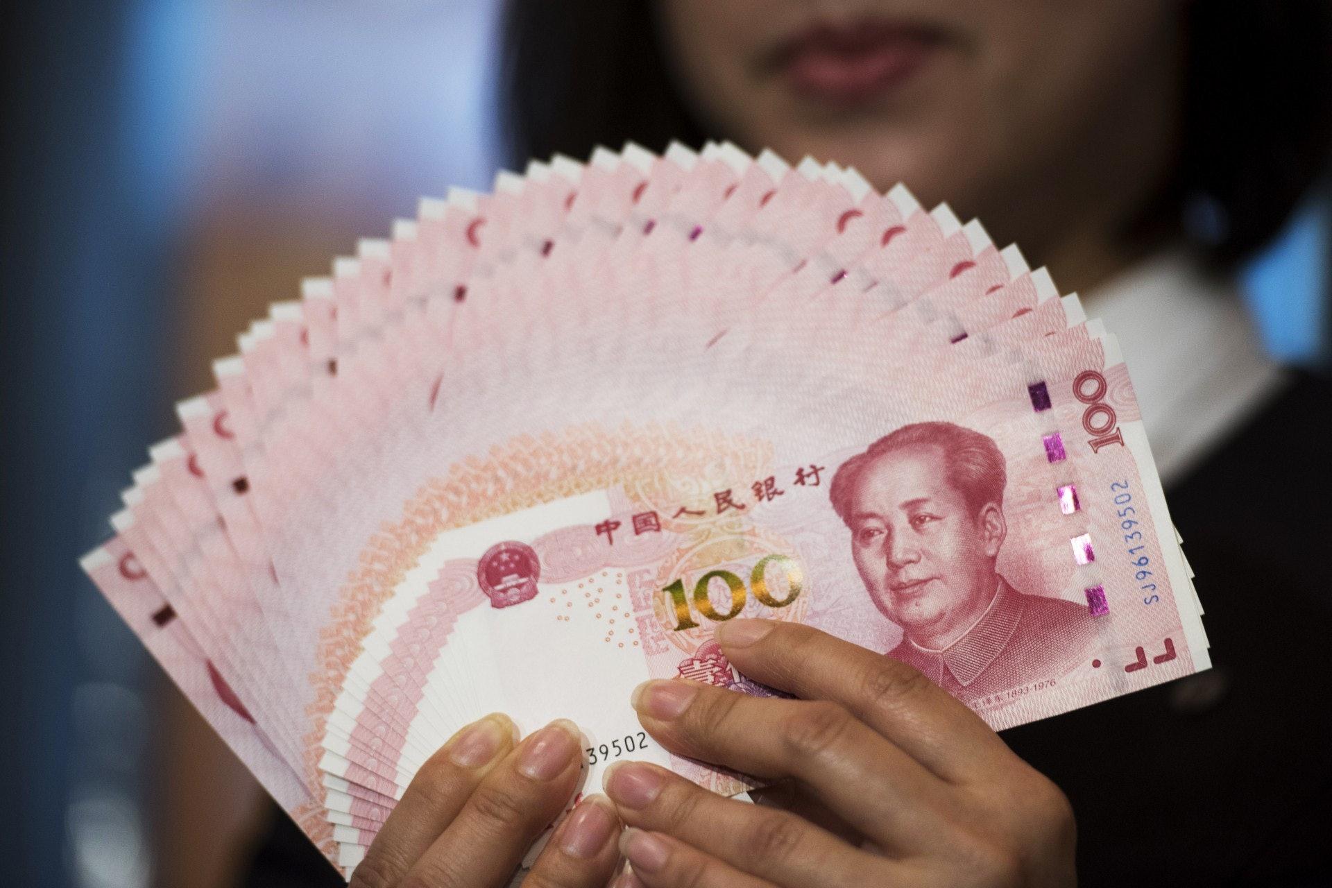 《路透社》調查發現人民幣的好倉上升至去年2月以來最高位。﹙視覺中國﹚